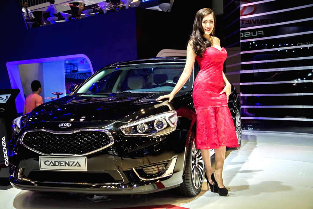 A model presents a Kia Cadenza car during the Vietnam Motor Show 2015 at Saigon Exhibition and Convention Centre in Ho Chi Minh city, Vietnam, Oct. 28, ...
