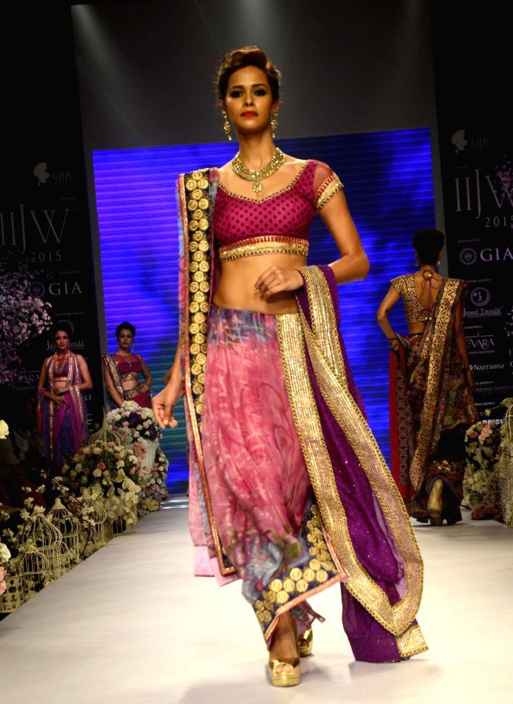 A model showcase creation of fashion designer Shaina NC at the India International Jewellery Week 2015, in Mumbai on Aug 3, 2015.