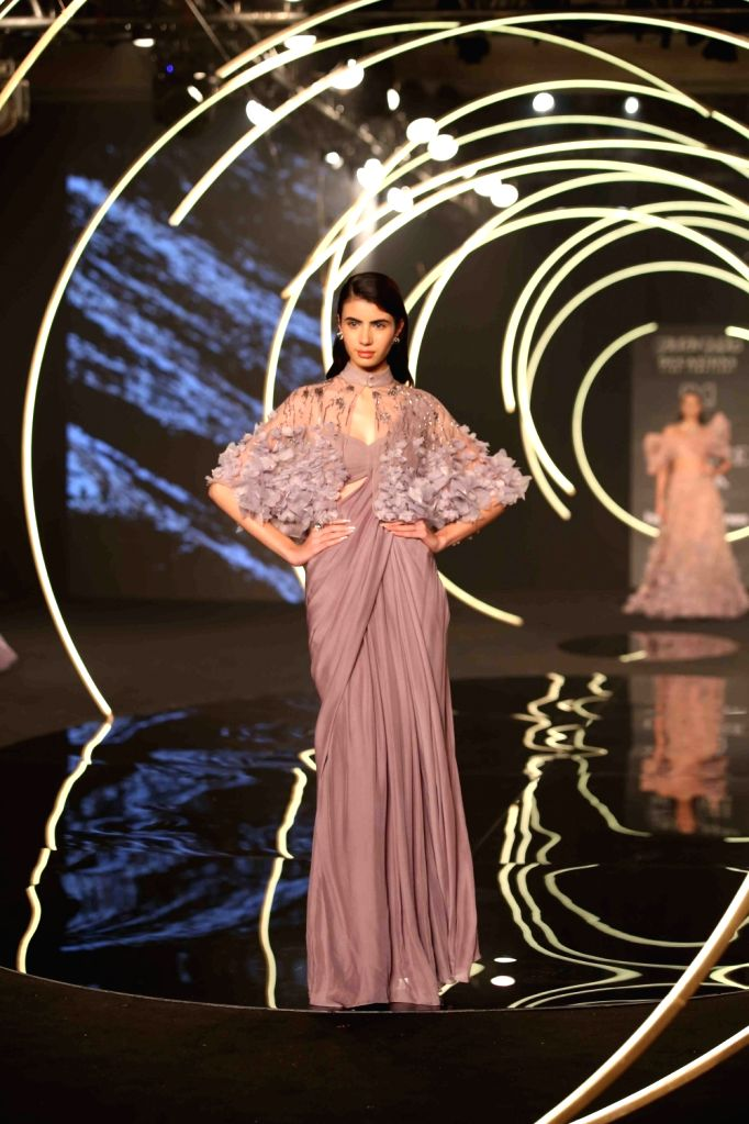 A model showcase fashion designer Gaurav Gupta's creations at the India Couture Week 2019 in New Delhi, on July 27, 2019. - Gaurav Gupta