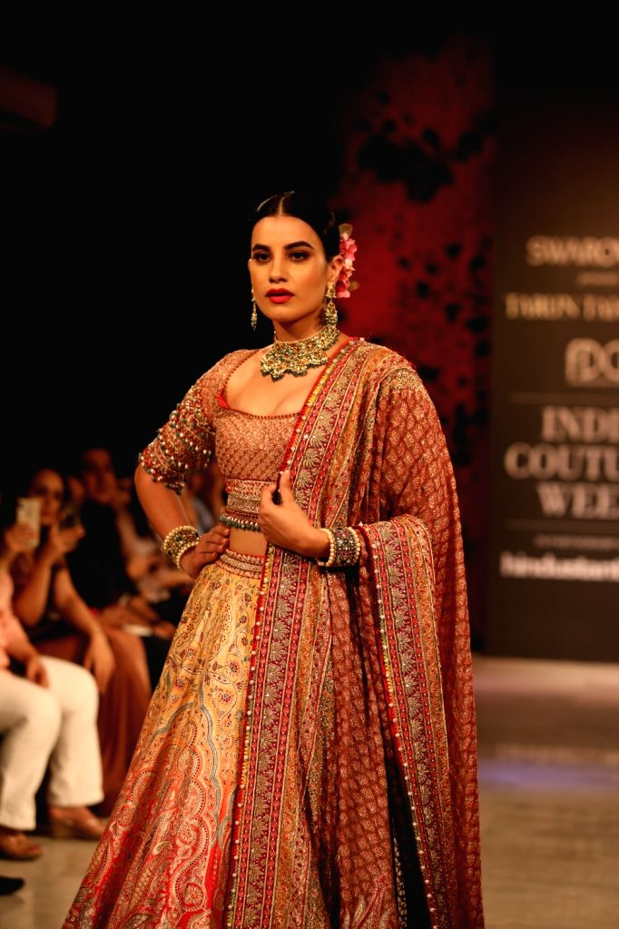 A model showcase fashion designer Tarun Tahiliani's creations at the India Couture Week 2019 in New Delhi, on July 28, 2019.