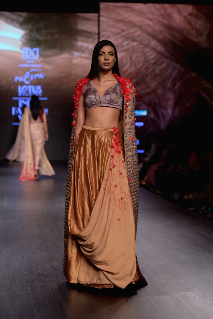 A model showcases a creation of fashion designer Ruceru on the third day of Lotus India Fashion Week in New Delhi, on March 15, 2019.