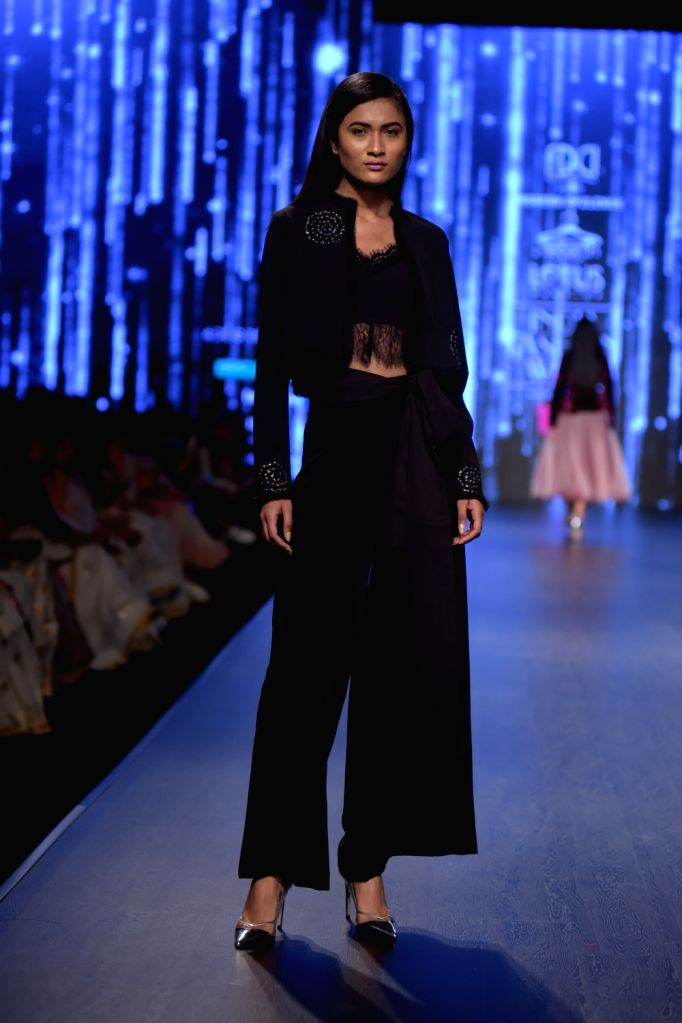A model showcases a creation of fashion designer Shivani Awasthy on the third day of Lotus India Fashion Week in New Delhi, on March 15, 2019.