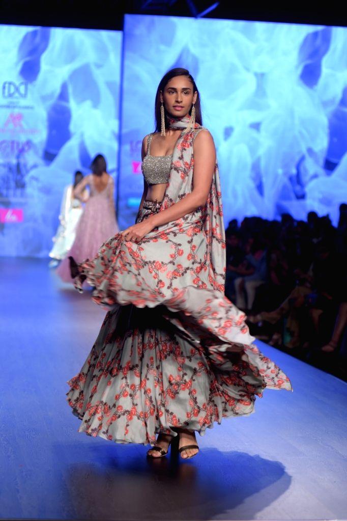 A model showcases a creation of fashion designer Ashwini Reddy on the third day of Lotus India Fashion Week in New Delhi, on March 15, 2019. - Ashwini Reddy