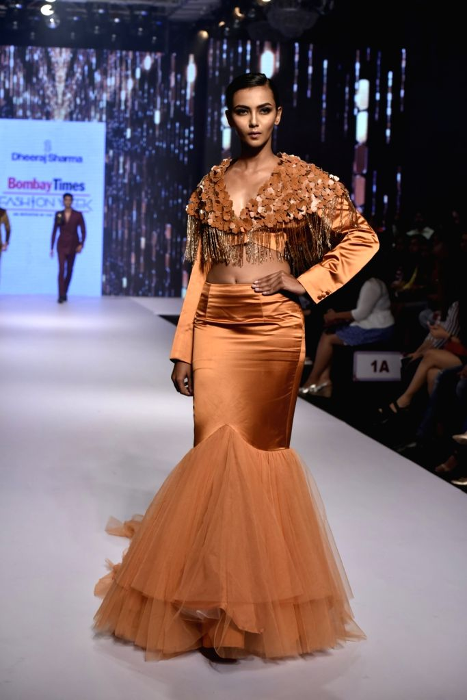 A model showcases a creation of fashion designer Dheeraj Sharma at Bombay Times Fashion Week Spring/ Summer 2019 in Mumbai, on March 25, 2019. - Dheeraj Sharma