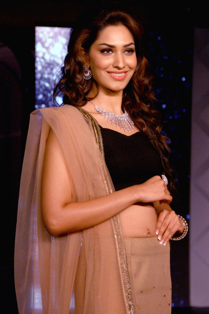 A model showcases a new range of jewellery during a fashion show in New Delhi on July 3, 2014.
