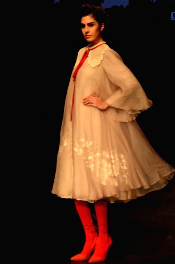 A model showcases Aikeyah's creation during the Lakme Fashion Week (LFW) Summer/Resort 2019 in Mumbai on Feb 2, 2019.