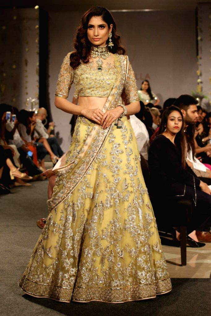 A model showcases creations of fashion designer Neeta Lulla at India Couture Week 2018 in New Delhi, on Aug 3, 2018.