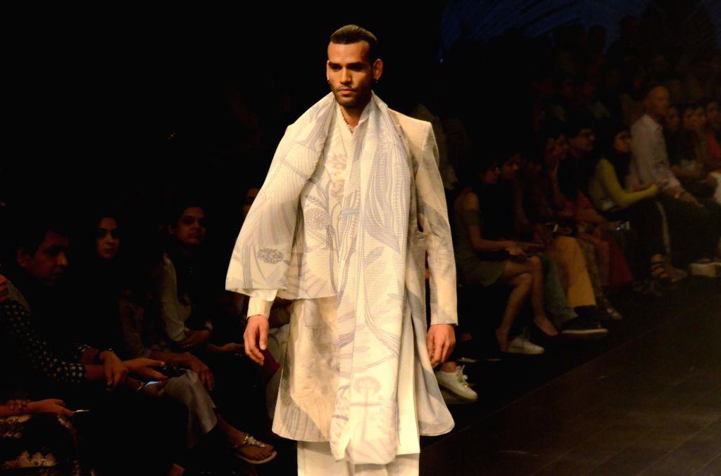 A model showcases fashion designer Abhishek Sharma's creation during the Lakme Fashion Week (LFW) Summer/Resort 2019 in Mumbai on Feb 2, 2019. - Abhishek Sharma