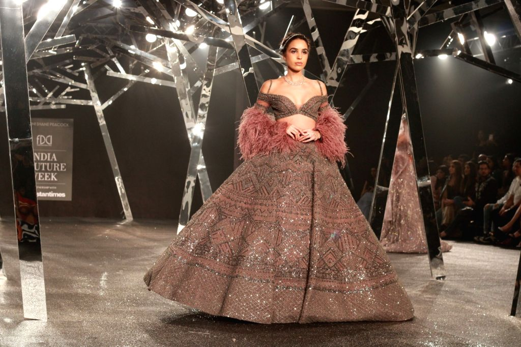 A model showcases fashion designer Falguni Peacock's creations at the India Couture Week 2019 in New Delhi, on July 26, 2019.