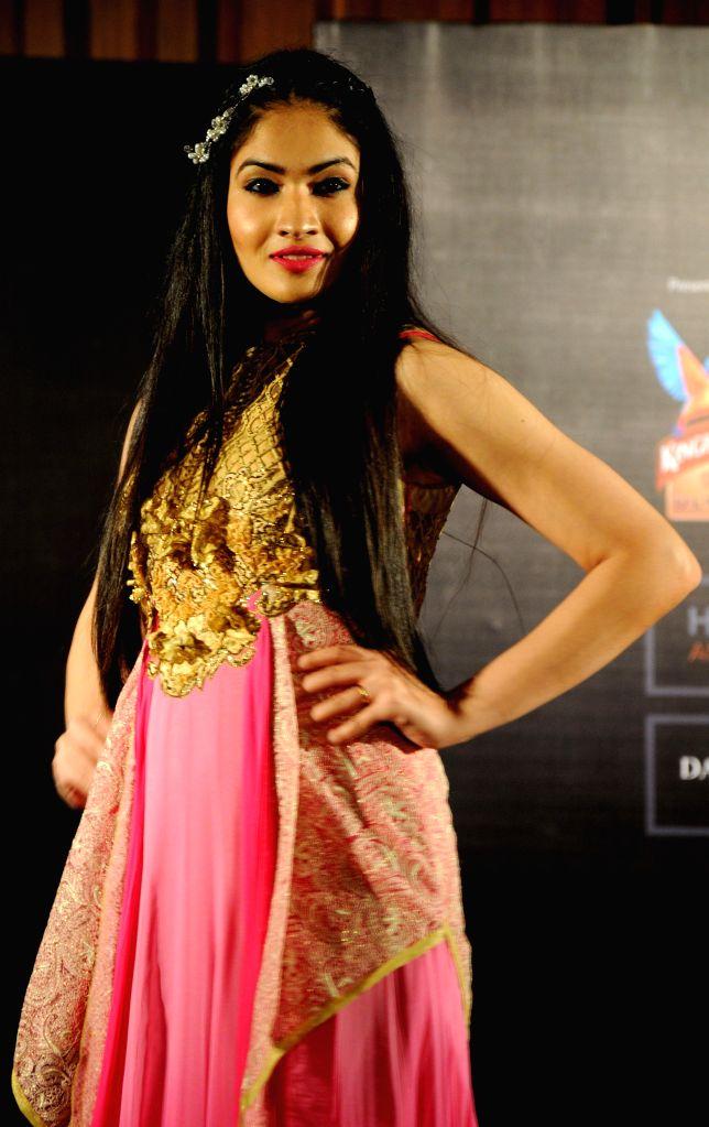 A model showcases fashion designer Jattinn Kochhar and Sheetal Lyall's creation during Kingfisher Ultra Punjab Style Tour in Amritsar on Aug 2, 2014.