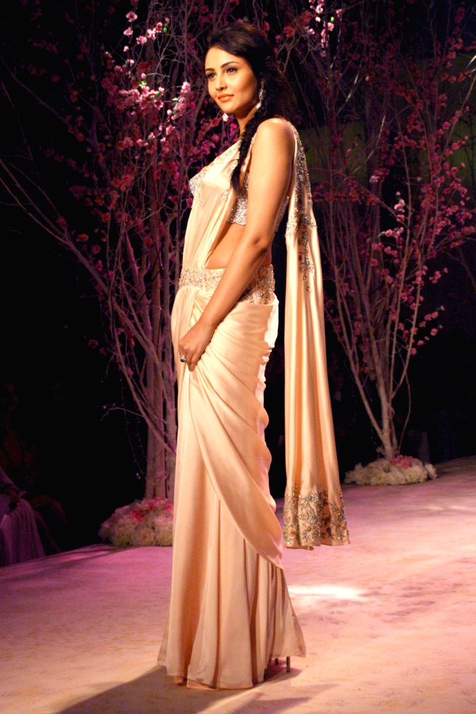 A model showcases fashion designer Jyotsna Tiwari's creation during  `BMW India Bridal Fashion Week 2014` in New Delhi on Aug 10, 2014.