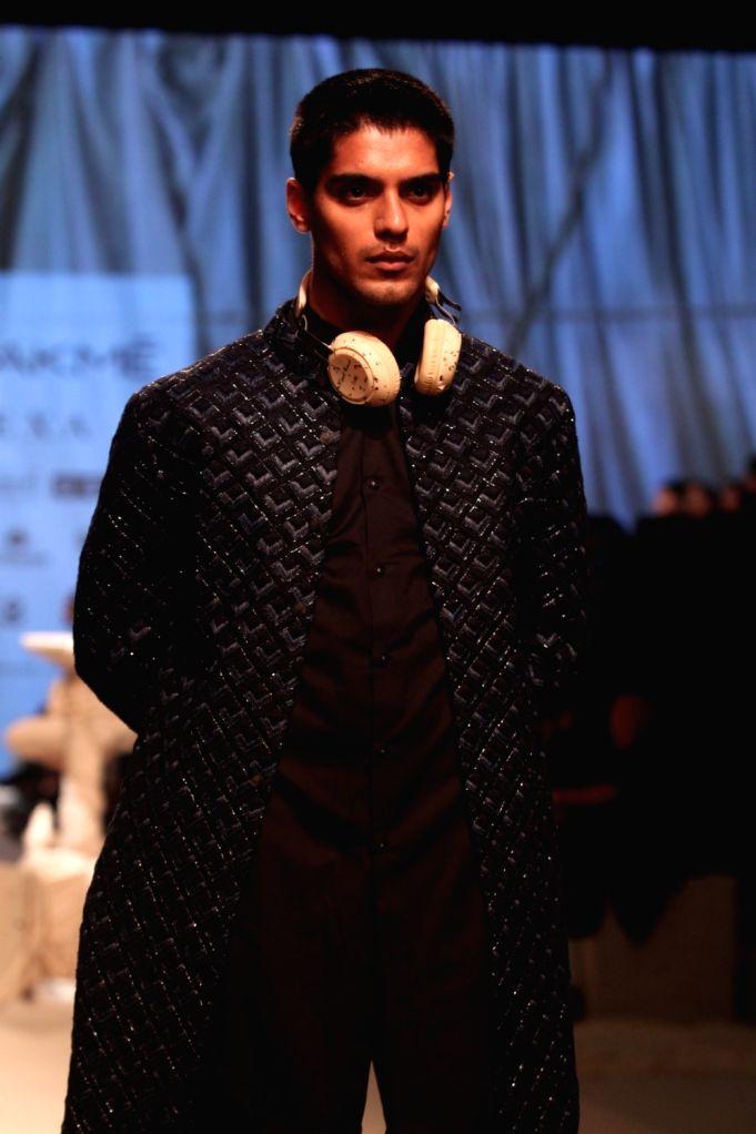 A model showcases fashion designer kunal Rawal's creation during Lakme Fashion Week (LFW) Summer/Resort 2019 in Mumbai, on Feb 3, 2019.