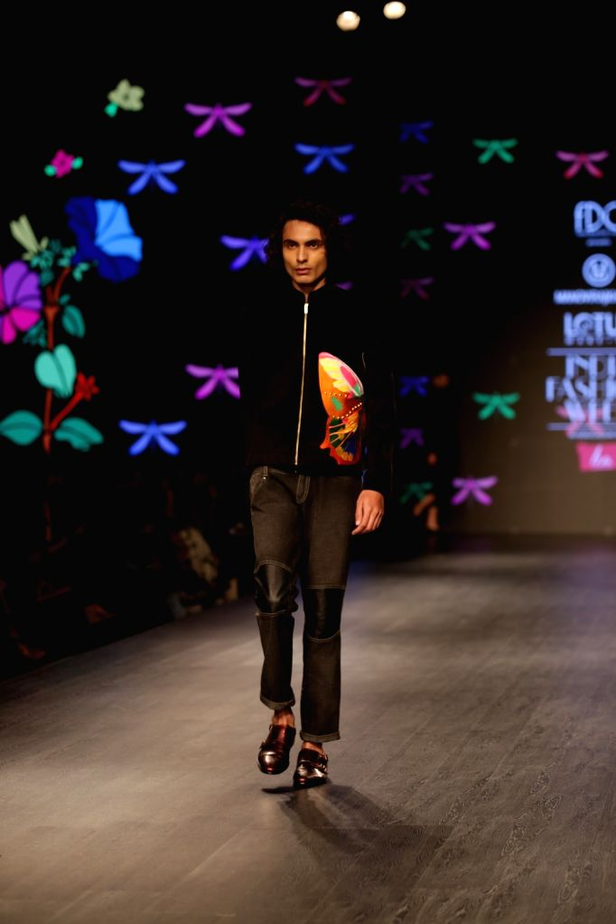 A model showcases fashion designer Manoviraj Khosla's creation on the second day of Lotus India Fashion Week in New Delhi, on March 14, 2019.