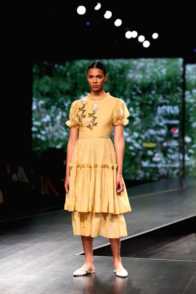 A model showcases fashion designer Nidhika Shekhar's creations on the third day of Lotus Make-up India Fashion Week, in New Delhi on Oct 11, 2019.