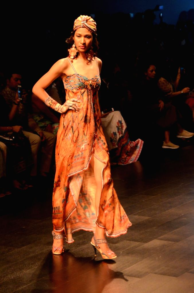 A model showcases fashion designer Rajdeep Ranawat's creation during Lakme Fashion Week (LFW) Summer/Resort 2019 in Mumbai, on Feb 1, 2019.
