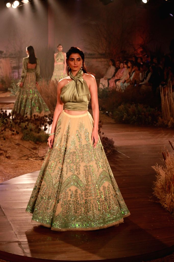 A model showcases fashion designer Reynu Tandon's creations at the India Couture Week 2019 in New Delhi, on July 26, 2019.