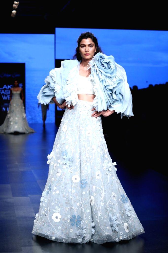 A model showcases fashion designer  Shriya Som's creation during Lakme Fashion Week (LFW) Summer/Resort 2019 in Mumbai, on Feb 3, 2019.