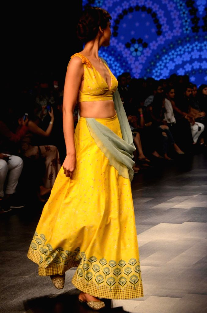 A model showcases fashion designer Varun Bahl's creation during Lakme Fashion Week (LFW) Summer/Resort 2019 in Mumbai, on Jan 30, 2019.