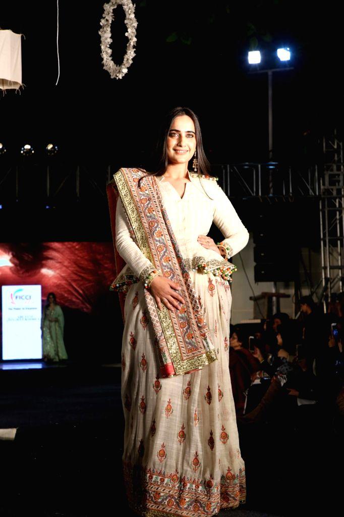 "A model showcases fashion designers Abu Jani and Sandeep Khosla's creation during ""Khadi Goes Global"" programme, in New Delhi, on Feb 21, 2019."