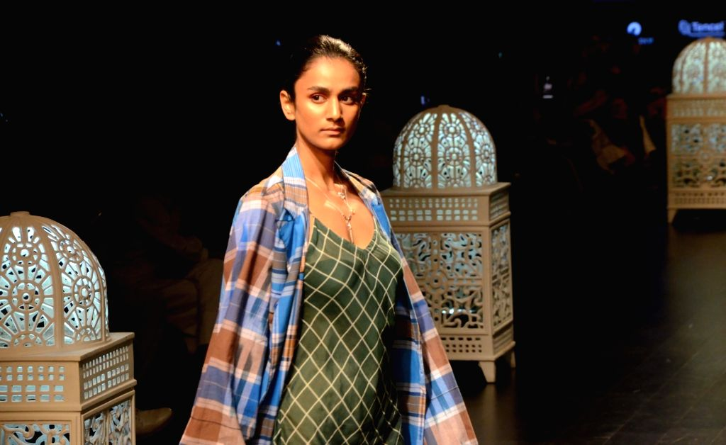 A model showcases fashion designers Saaksha and Kinni's creation during Lakme Fashion Week (LFW) Summer/Resort 2019 in Mumbai, on Feb 2, 2019.