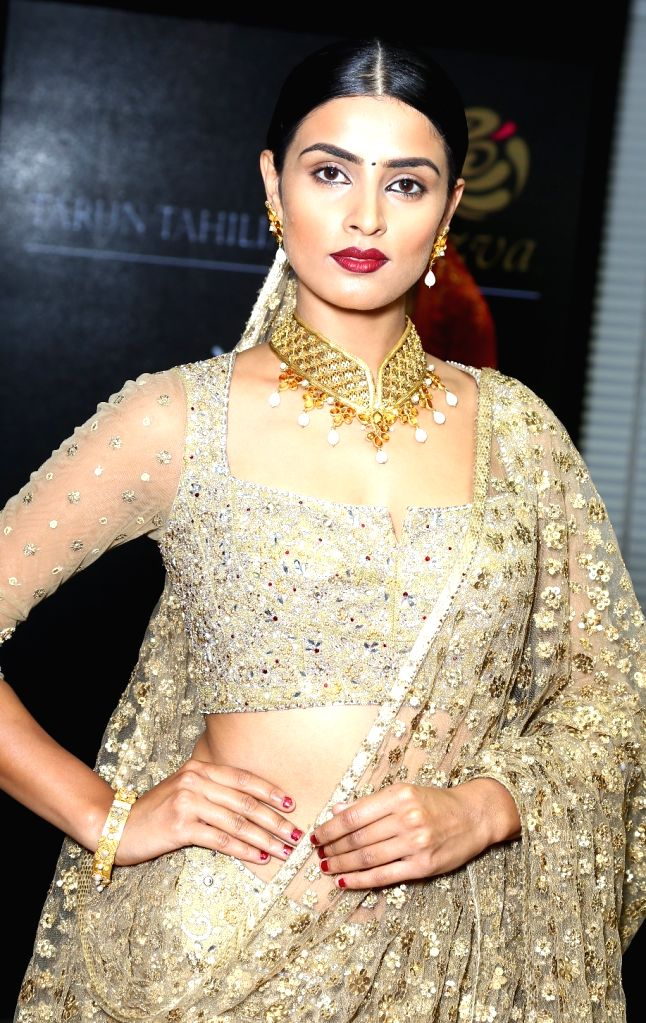 A model showcases Tarun Tahiliani's creations during a programme in New Delhi, on April 3, 2015.