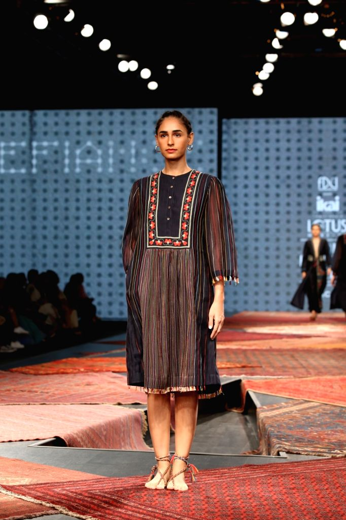 A model showcases the collection from fashion designer Ragini Ahuja's fashion label Ikai on the first day of Lotus India Fashion Week, in New Delhi on Oct 9, 2019.