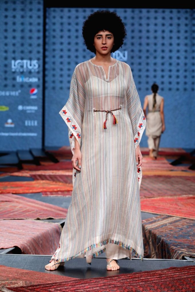 A model showcases the collection from fashion designer Ragini Ahuja's fashion label Ikai on the first day of Lotus Make-up India Fashion Week, in New Delhi on Oct 9, 2019.