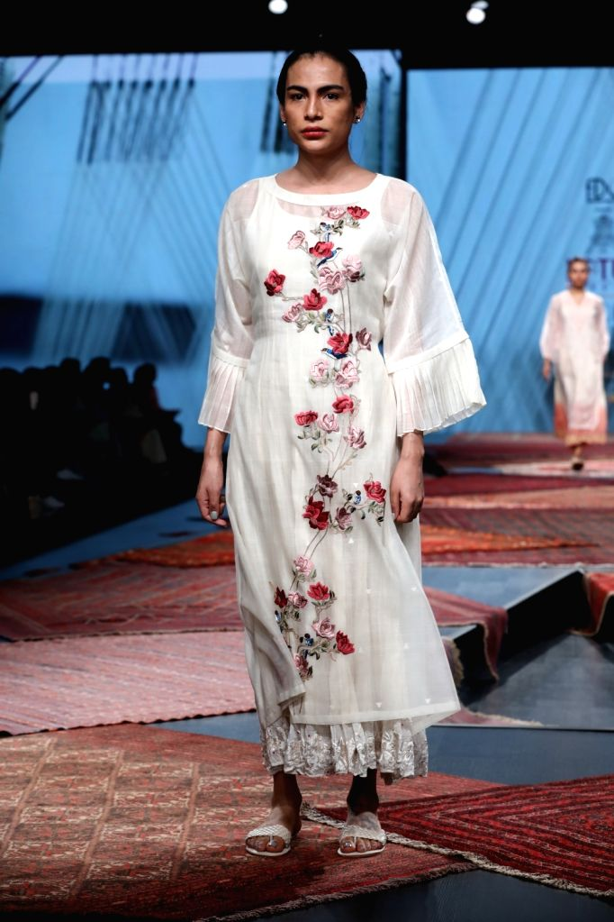 A model showcases the collection from fashion designer Pratima Pandey's fashion label Prama on the first day of Lotus Make-up India Fashion Week, in New Delhi on Oct 9, 2019. - Pratima Pandey