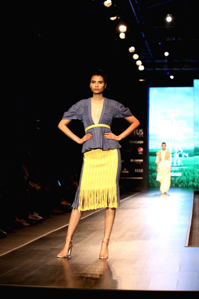 A model showcases the collection from fashion designer Amita Gupta's lineup 'Sustainable' on the first day of Lotus Make-up India Fashion Week, in New Delhi on Oct 9, 2019. - Amita Gupta