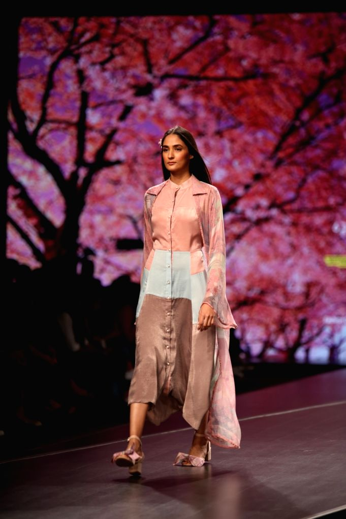 A model showcases the collection from fashion designer Shruti Sancheti's fashion label 'Abstract' on the second day of Lotus Make-up India Fashion Week, in New Delhi on Oct 10, 2019.