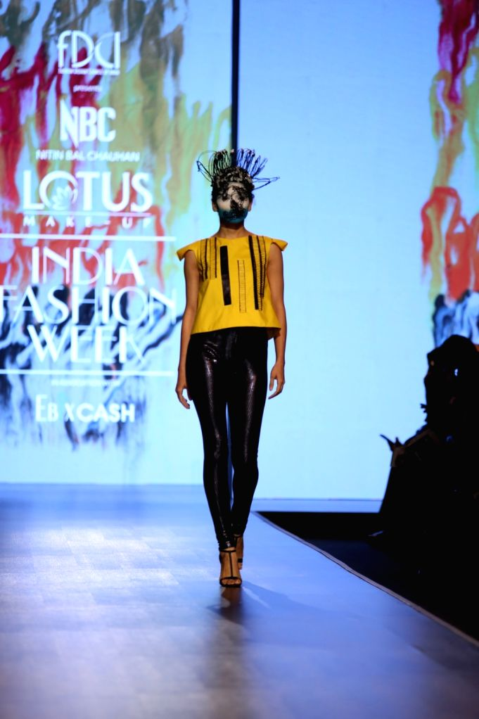 A model showcases the collection from fashion designer Nitin Bal Chauhan's fashion label 'Abstract' on the second day of Lotus Make-up India Fashion Week, in New Delhi on Oct 10, 2019. - Nitin Bal Chauhan