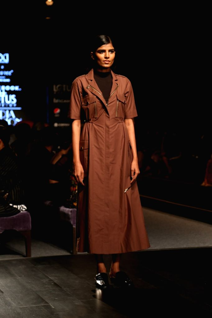 A model showcases the collection of fashion label Notebook on the fourth day of Lotus Make-up India Fashion Week, in New Delhi on Oct 12, 2019.