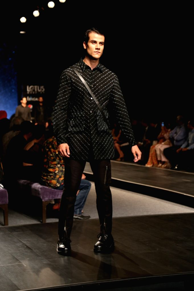 A model showcases the collection of fashion label Countrymade on the fourth day of Lotus Make-up India Fashion Week, in New Delhi on Oct 12, 2019.
