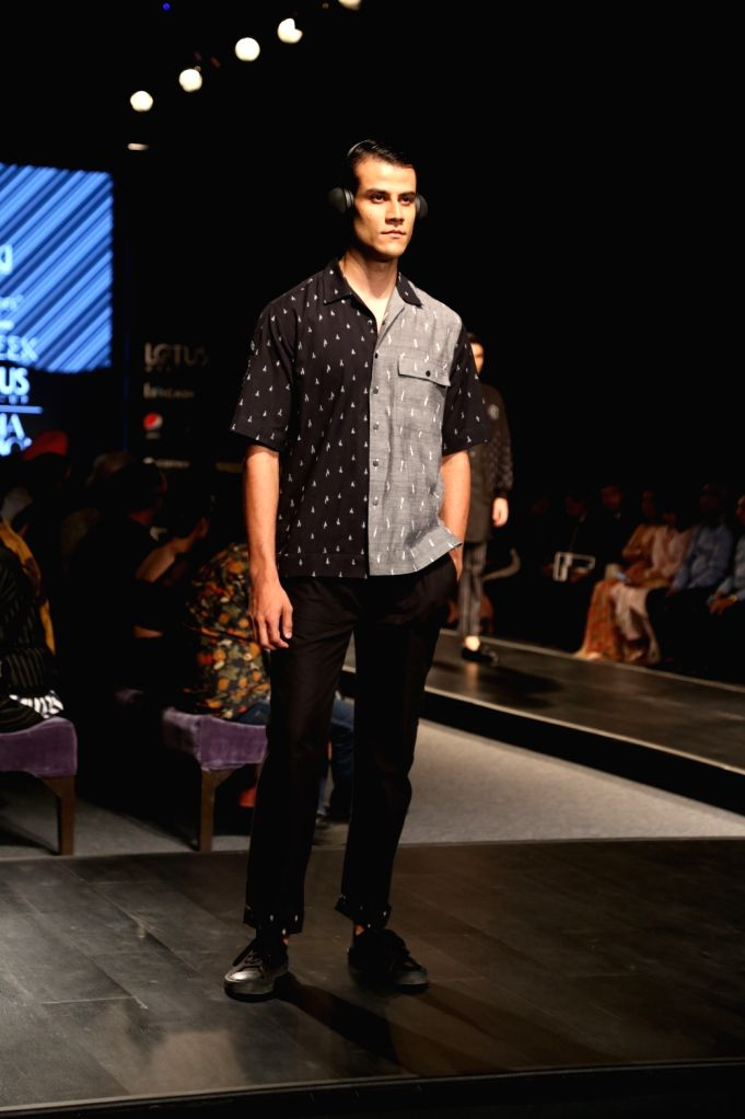 A model showcases the collection of menswear label Bareek on the fourth day of Lotus Make-up India Fashion Week, in New Delhi on Oct 12, 2019.