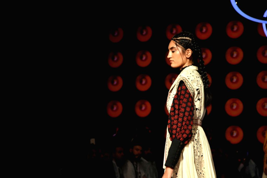 A model showcases the creation of a student of Inter National Institute of Fashion Design West Delhi (INIFD) on Day 2 of the Lakme Fashion Week Summer/Resort 2020, in Mumbai on Feb 12, 2020.