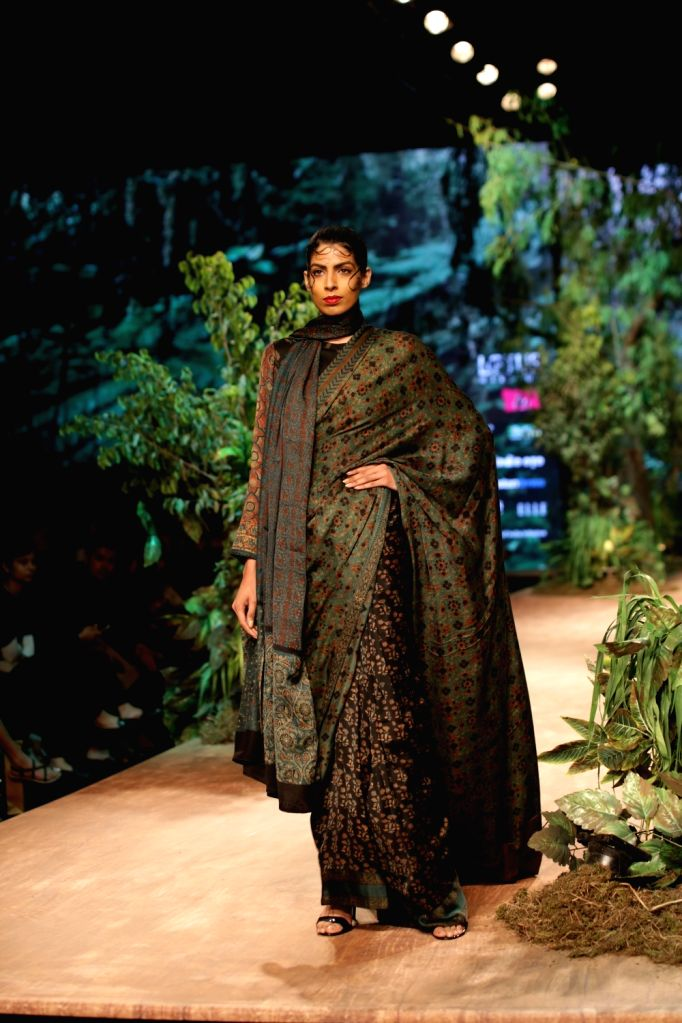 A model showcases the creation of fashion designer Shalini James on the opening day of Lotus India Fashion Week in New Delhi, on March 13, 2019.