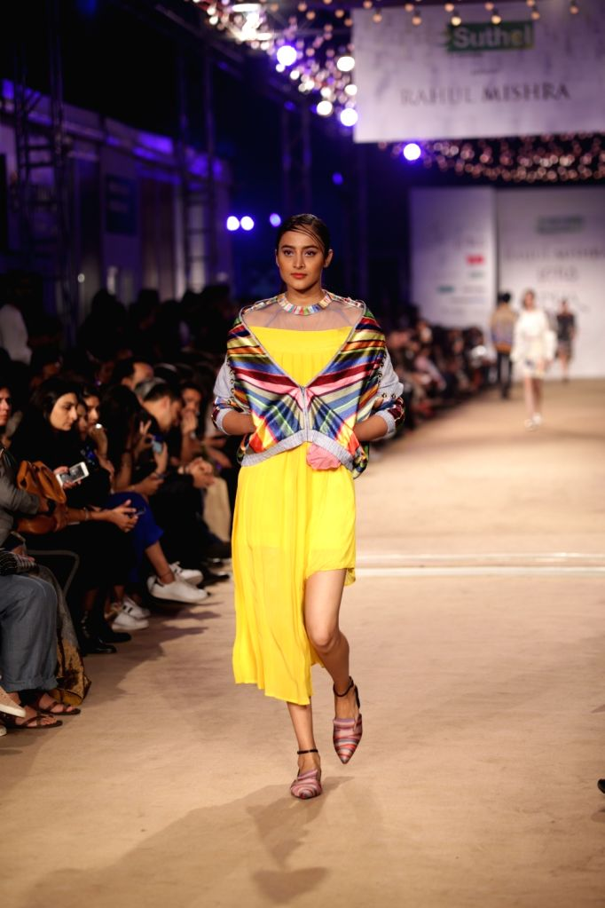 A model showcases the creation of fashion designer Rahul Mishra on the opening day of Lotus India Fashion Week in New Delhi, on March 13, 2019. - Rahul Mishra