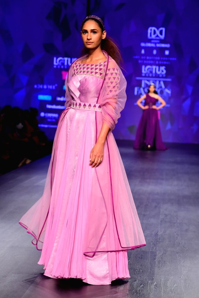 A model showcases the creation of fashion designers Gauri and Kunal's AOM couture on the second day of Lotus India Fashion Week in New Delhi, on March 14, 2019.