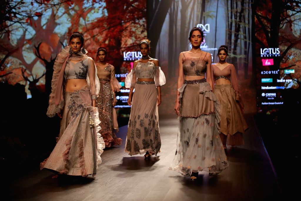 A model showcases the creation of fashion designer Prreeti Jaiin Nainutia on the second day of Lotus India Fashion Week in New Delhi, on March 14, 2019.