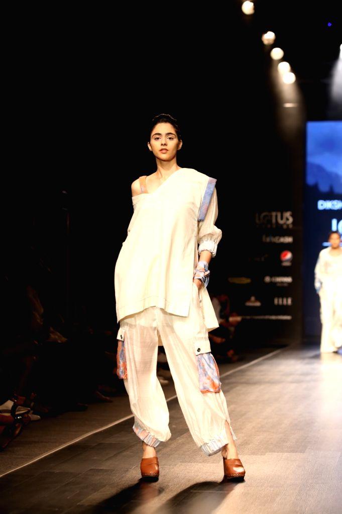 A model showcases the creation of fashion designer Diksha Khanna on the first day of Lotus Make-up India Fashion Week, in New Delhi on Oct 9, 2019. - Diksha Khanna