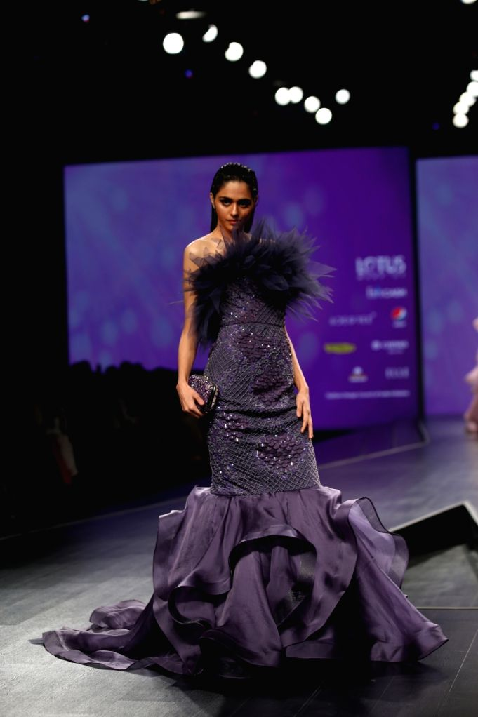 A model showcases the creation of fashion designer Amit GT on the third day of Lotus Make-up India Fashion Week, in New Delhi on Oct 11, 2019.