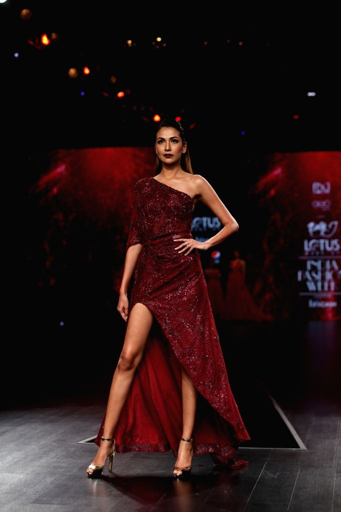 A model showcases the creation of fashion designer Dolly J on the third day of Lotus Make-up India Fashion Week, in New Delhi on Oct 11, 2019.