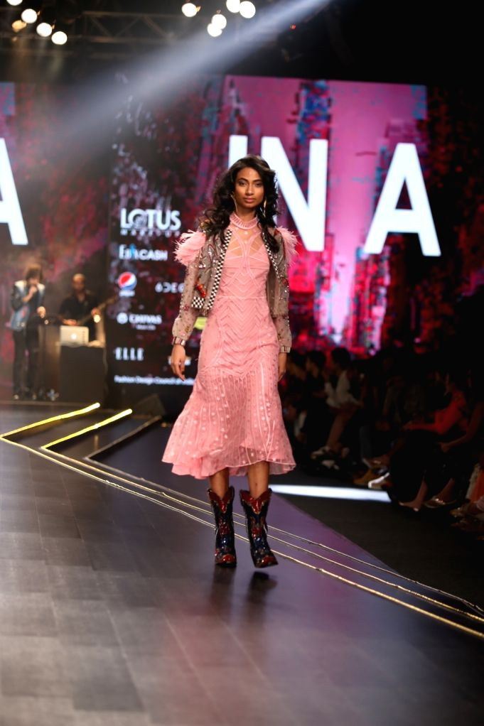 A model showcases the creation of fashion luxury label 'Falguni Shane Peacock' on the second day of Lotus Make-up India Fashion Week where collections from her fashion label 'Abstract' ...