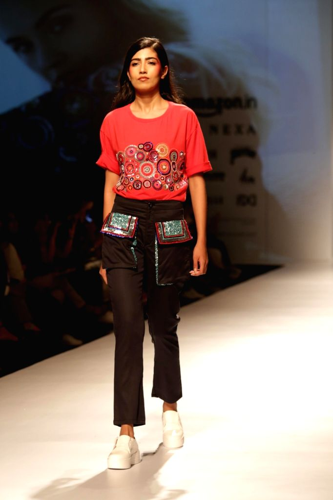 A model showcases the creations at Amazon India Fashion Week Summer Spring in New Delhi, on Oct 11, 2017.