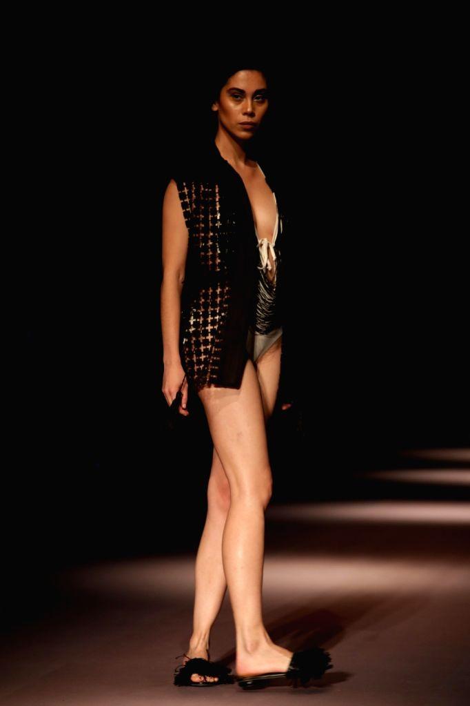 A model showcases the creations of Fashion Designer Rimzim Dadu at Amazon India Fashion Week Summer Spring in New Delhi, on Oct 11, 2017.