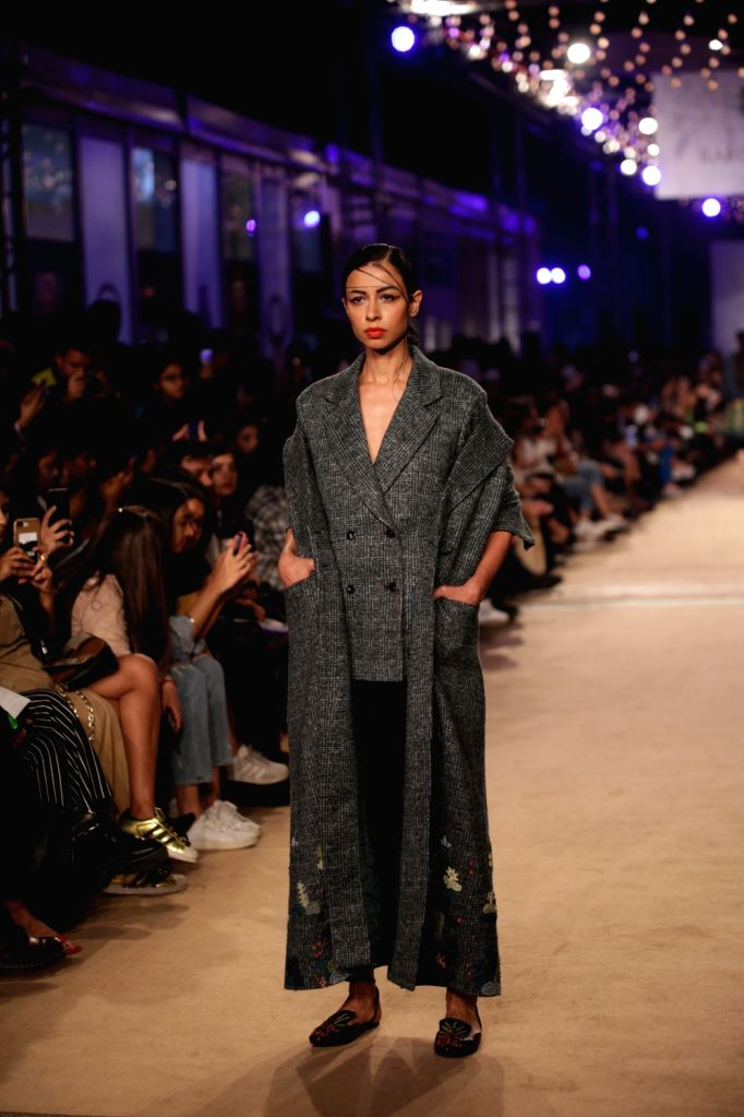 A model showcases the creations of fashion designer Rahul Mishra on the opening day of Lotus India Fashion Week in New Delhi, on March 13, 2019. - Rahul Mishra