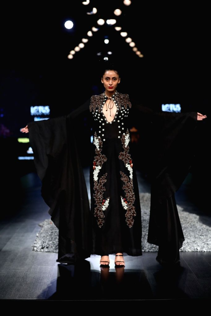 A model showcases the creations of fashion designer Samant Chauhan on the first day of Lotus Make-up India Fashion Week, in New Delhi on Oct 9, 2019. - Samant Chauhan