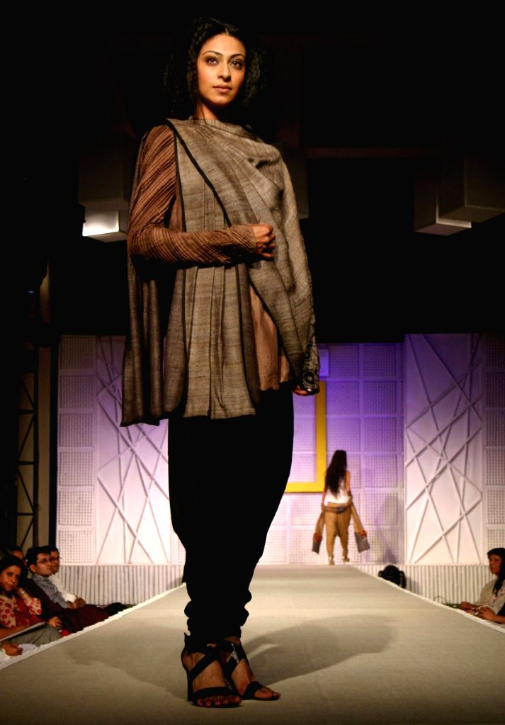 A Model showcasing Designer Kakoli Banerjee's Eco-Friendly Collection at a Fashion show organisedby National Geographic Channel in New Delhi on Wednesday night.