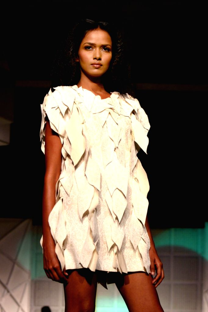 A Model showcasing Designer Mark Liu's Eco-Friendly Collection at a Fashion show organisedby National Geographic Channel in New Delhi on Wednesday night.