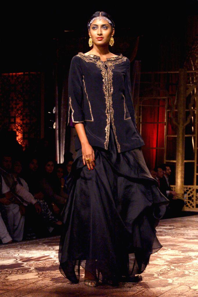 A model showcasing designer Raghavendra Rathore`s creations during `BMW India Bridal Fashion Week 2014`, in New Delhi on Aug. 8,2014.